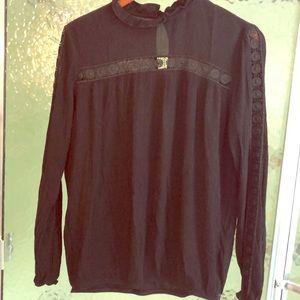 Beautiful black blouson top, arm & chest detail